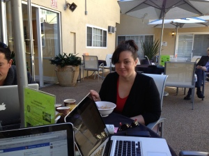 Tamar preparing her lecture by the pool